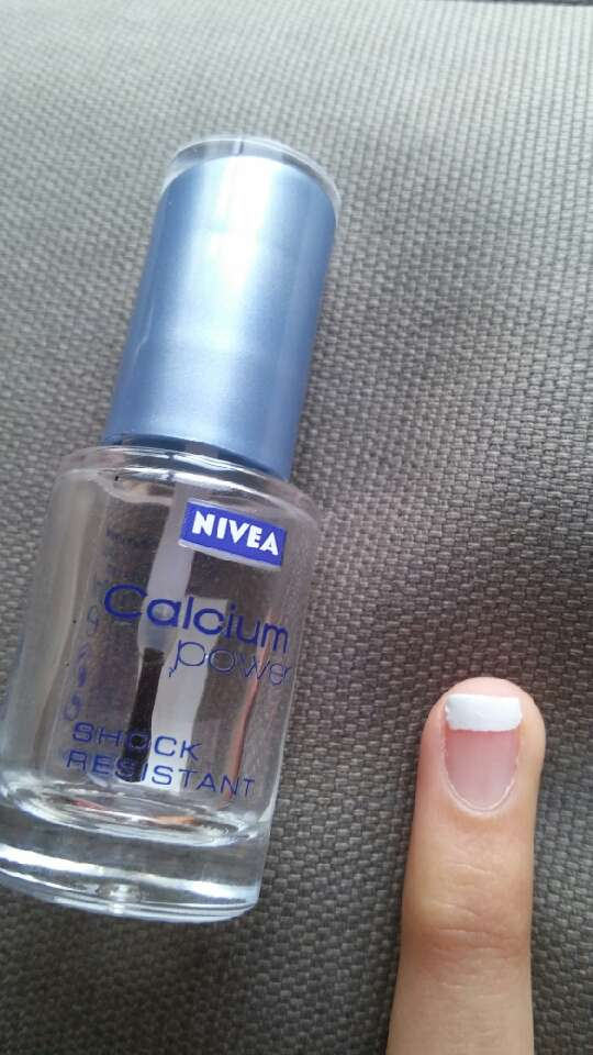 Time to apply the transparent nail polish on your nail.