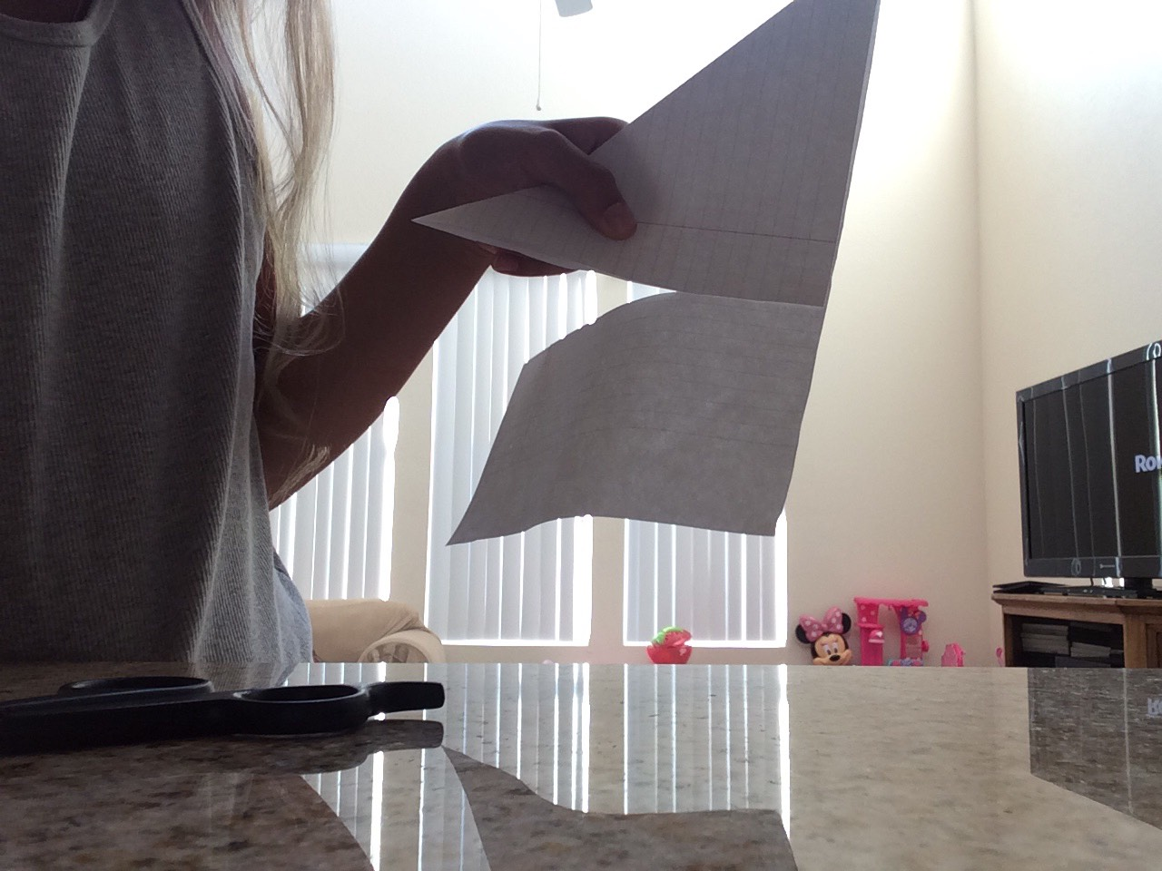 Cut off the paper that is not part of the triangle, it will no longer be needed!✂️👍