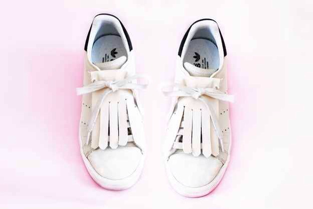 14. Or add a little faux leather fringe to freshen up an older pair. For leather sneakers, opt for artificial leather fabric since it's more waterproof than real leather. Measure and cut out the fringe and then tuck it into the tongue of your sneaker.