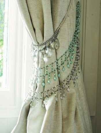 2. Repurpose your old rhinestone necklaces to make curtain tiebacks for a bohemian-inspired home.