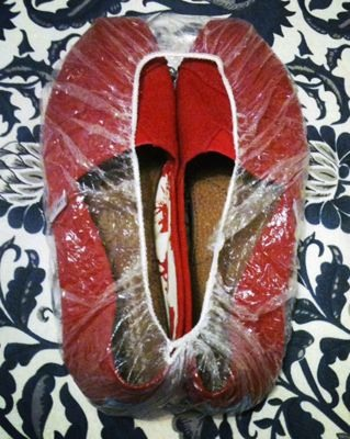 Use an old shower cap to cover bottom of shoes.