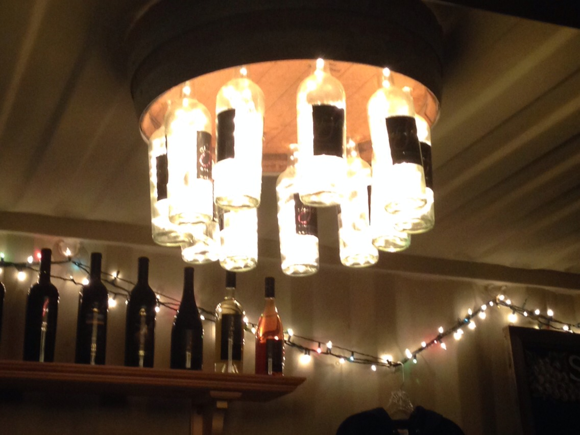 This such a clever idea! It's wine bottles and they put lights in them.