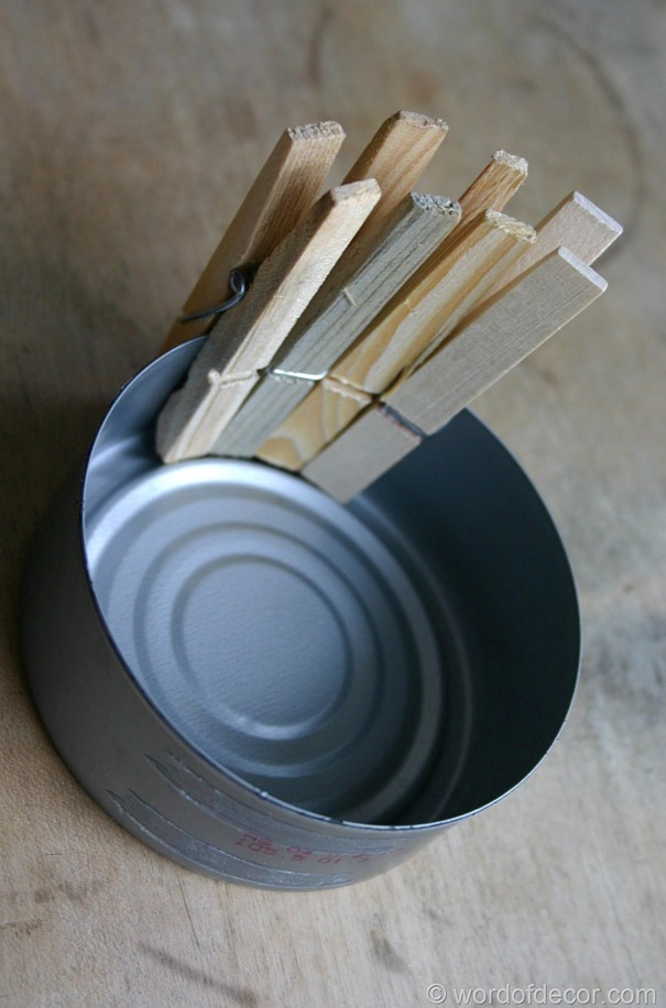 Closely arrange the clothes pins around the tin can.