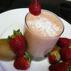 Crazy Coconut Fruit Smoothie: 1 1/2 cups crushed ice 1 banana (sliced) 1 kiwi (peeled and chopped) 1/2 cup chopped strawberries  1/2 cup chopped pineapple 1/4 cup cream of coconut 1 tablespoon coconut flakes for garnish