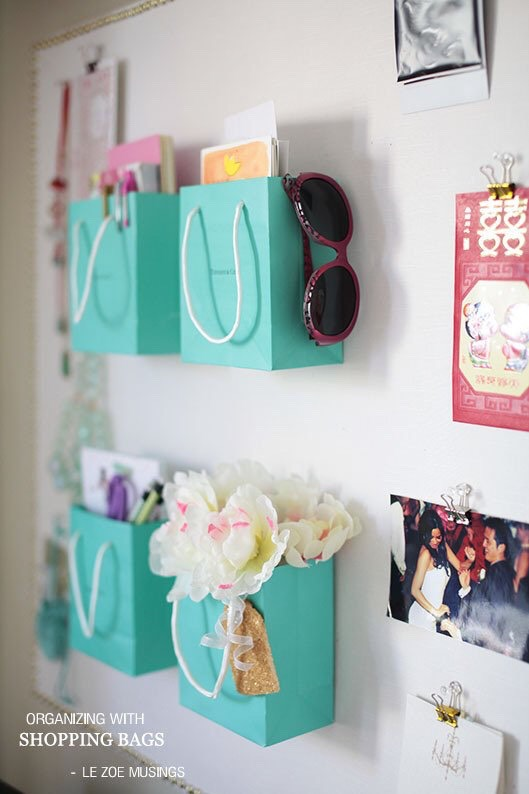 Use bags as decor on the walls.