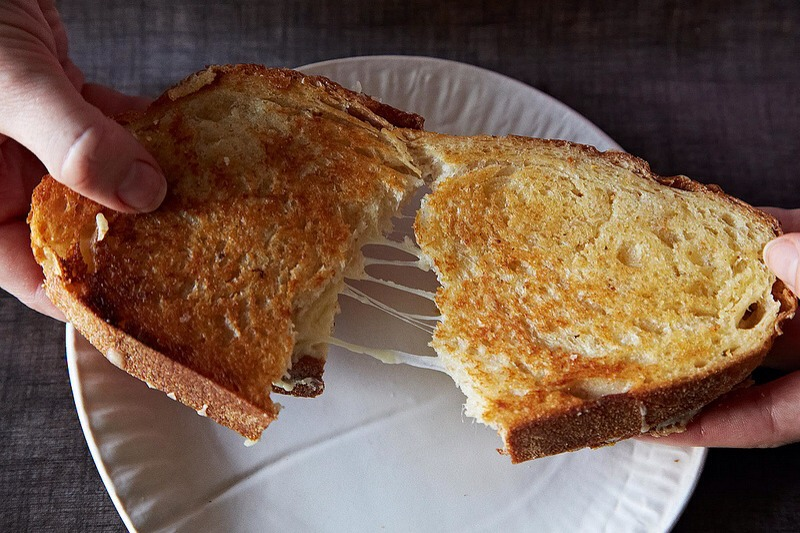 A perfectly executed grilled cheese sandwich relies on a number of factors, the most important being: Textural contrast, cheese that melts, and avoiding burnt toast at all costs. Also, a lot of butter.