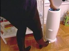Diaper Genie cleaner. A quick swipe of a wipe on the blade (where you cut the plastic) immediately eliminates any smell. The alcohol on the wipe kills the bacteria on the razor.