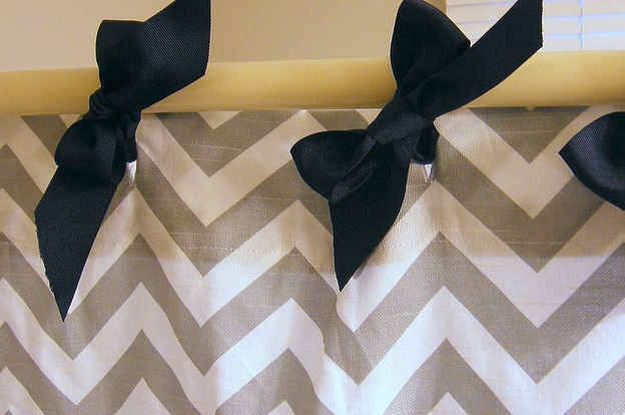 Use ribbons or strings to tie bows in for the shower curtain instead of using the typical rings.