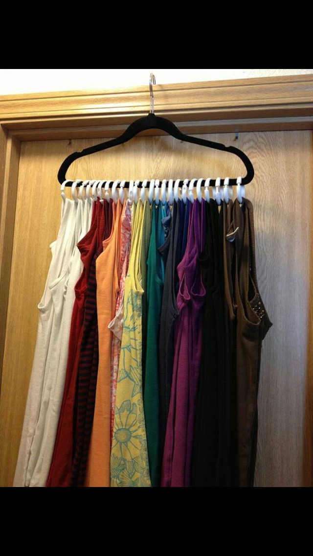 Use a hanger with Shower curtain rings to organize your tank tops.  Please like