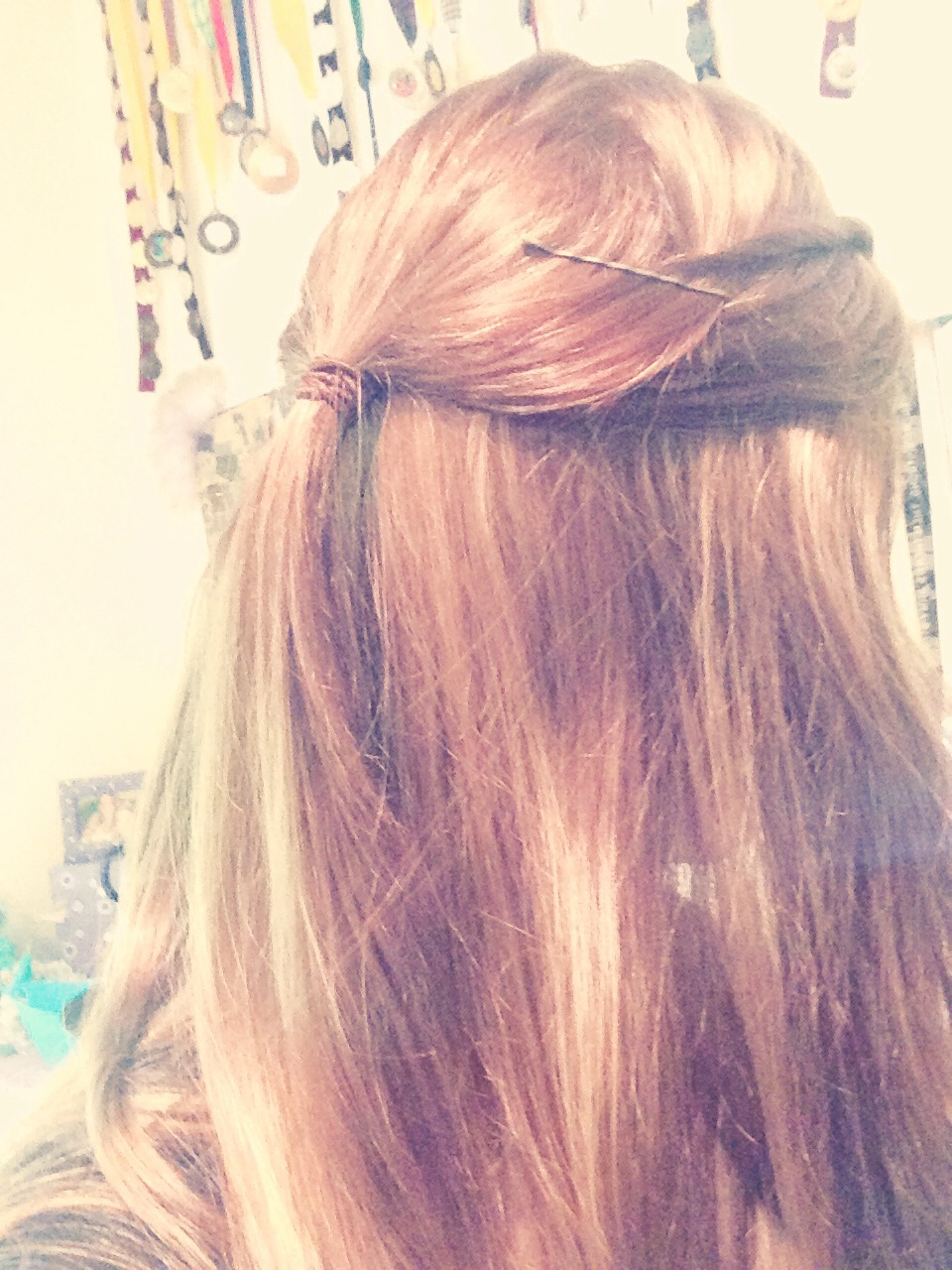 Tie up 1/2 your hair into small pony tail