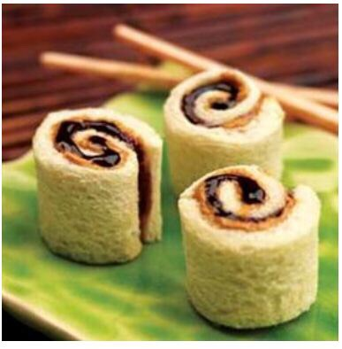 Peanut butter and jelly (or chocolate) bread sushi rolls