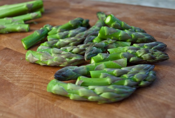 While that's going, prep the asparagus. Trim off the tips (you'll use them for a garnish), then cut the remaining spears into 1/2-inch pieces.