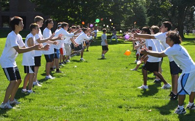 Have a water balloon toss with a friend!