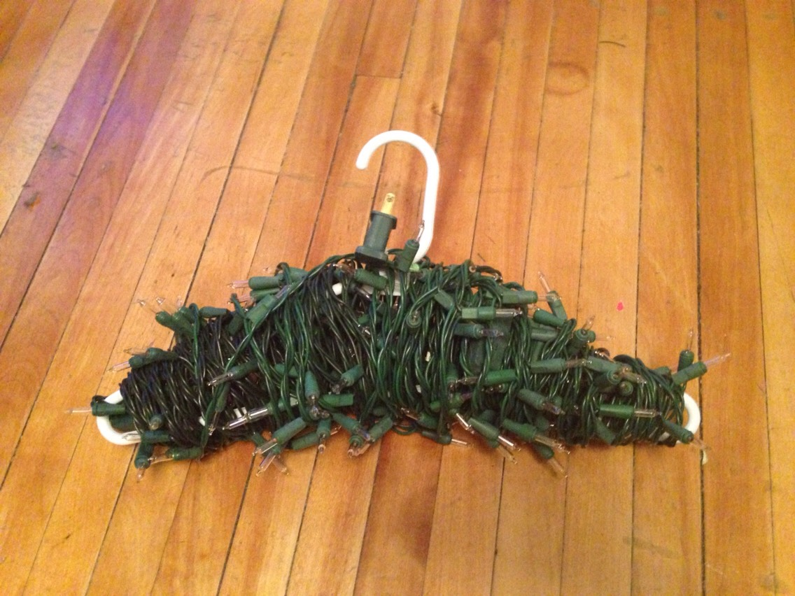 2. Keep wrapping until string is fully wrapped on hanger.  To ensure the lights stay secure during storage either tie the end to the hanger or use tape.