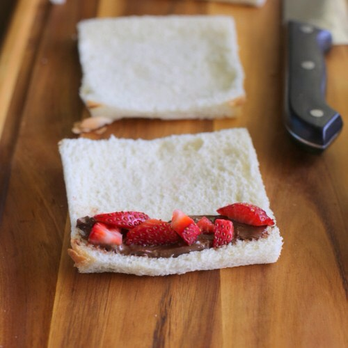 4. Put Nutella one side of bread.