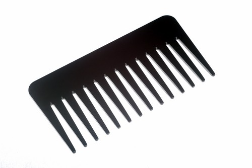 When finished curling your hair get a wide toothed comb and brush through it until it's the way you want it.