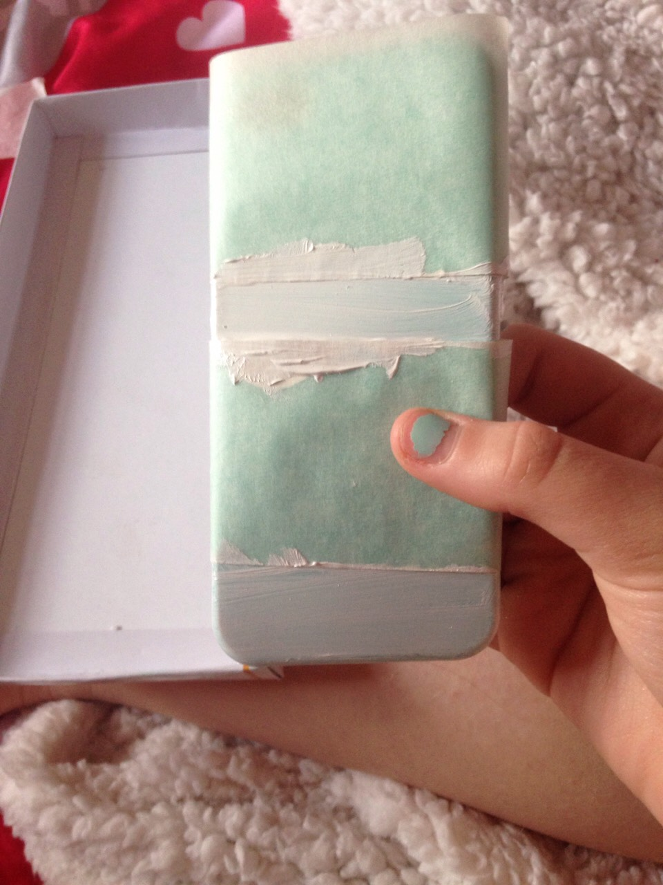 Paint the case and let it dry and then take off the tape and if u want it to stay spray hairspray  on it