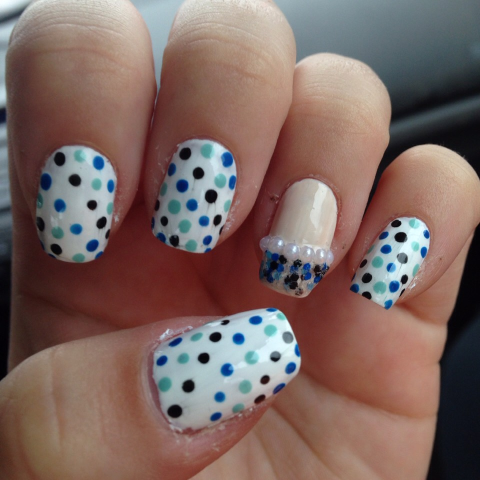 Blue dots with glitter tip accent nail with half pearls