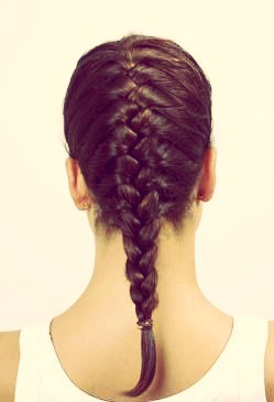 Braid damp hair into a French braid or just regular braids (the smaller the braids, the wavier the hair).