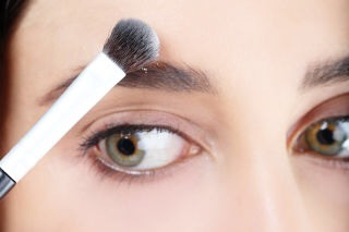 STEP 8  Use a fluffy brush to apply power or foundation around the outside of your brow to give it a sharp and clean look.