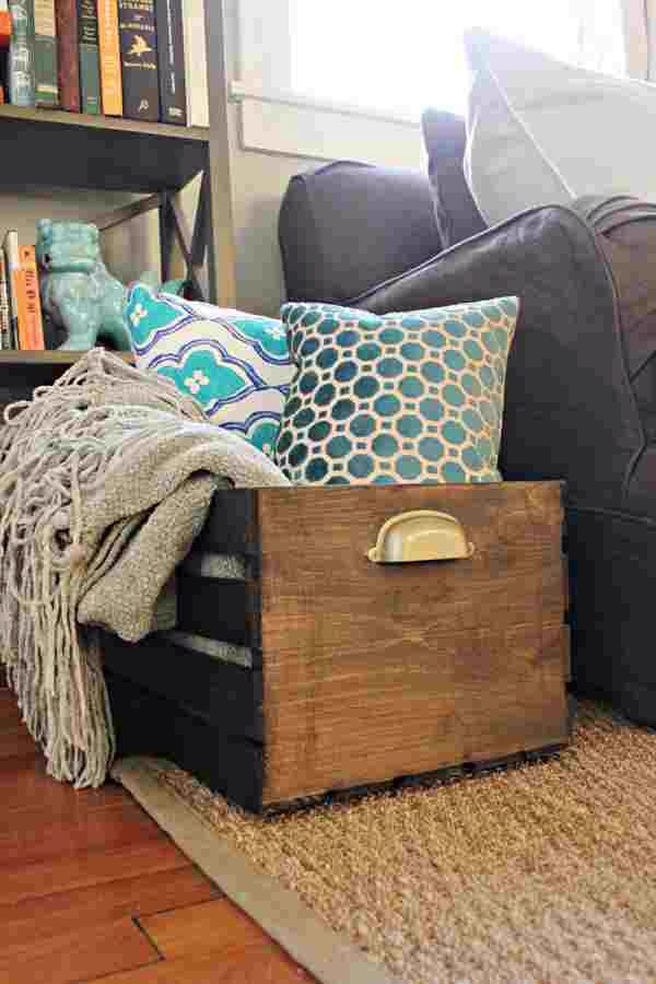 I had a strange space to fill in my living room and I needed blanket storage as well- so if you go to michaels and Download their 50% off coupon you can pick up a crate for $7! Just stain and prop