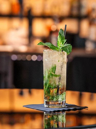 Classic Mint Julep  2 oz Woodford Reserve 1 oz Water 1 teaspoon Simple Syrup 4 sprigs of Fresh Mint  Crush mint leaves in a highball glass, fill with ice. Add Simple Syrup and Water. Add Woodford and stir until the glass frosts. Garnish with a mint sprig