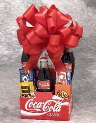 Gift basket for the movie lover using a coke box. Add some movie tickets to complete this awesome gift👍
