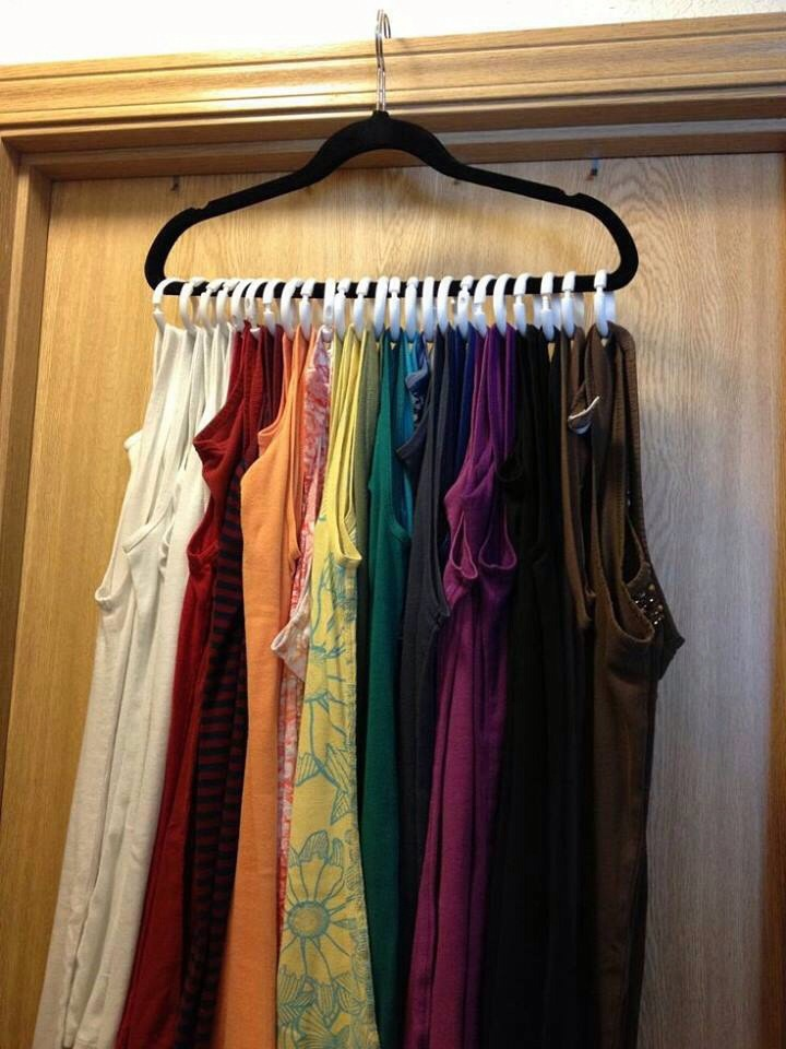 Use shower rings and one hanger, hang the tank tops on shower rings and have an awesome organized array of tank tops!