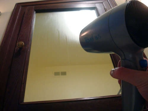 Use hair dryer to clear up steamed mirror after a hot shower