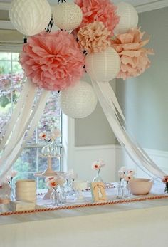 Hanging lanterns and pompoms add height. And are something beautiful.
