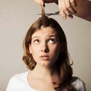 Cut 3/4 of an inch off your hair every month.