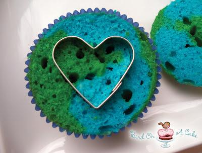 Press a small heart-shaped cookie cutter into the center of the cupcake.