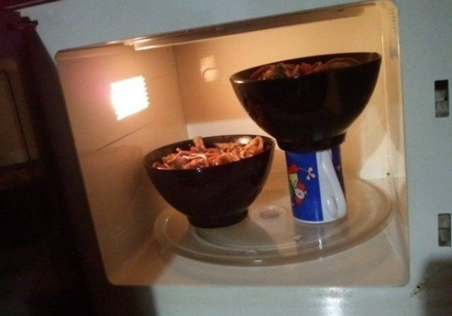 Using a microwave safe mug to create two different heights will allow you to cook two dishes at once evenly!