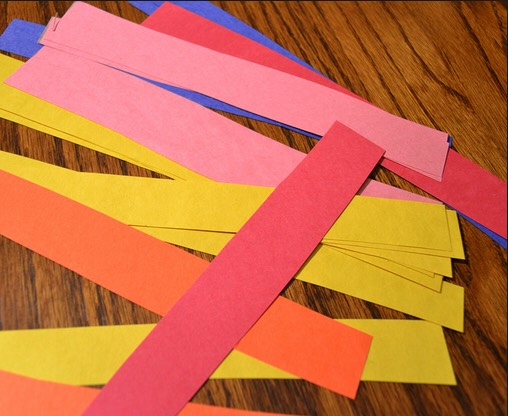 Cut the paper into strips...