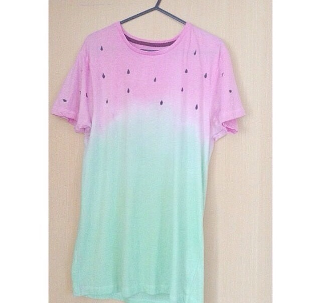 After you've dip dyed both ends in different colours, put the top on a washing line to dry an leave it hanging for about 4 hours, or when ever it's dry. Once it's dry you get a PERMANENT marker and draw tear drop shapes all over the pink area to create the seeds.