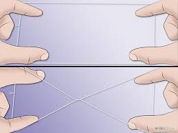 Tie the ends of a cotton thread to form a circle. Hold the part with the knot in one hand and the opposite section with the other hand and twist it 5-6 times.
