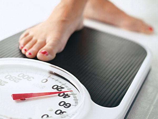 You lose more weight while on your period and excersizing so don't skip out on a week of excersizing.