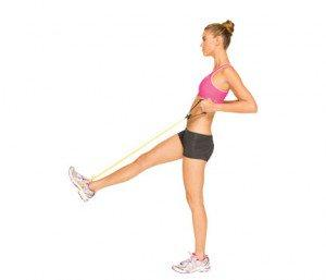 3) Brest In Show Row Stand on left leg, loop band around right foot and hold an end in each hand. Extend right leg and arms out in front of you to start. Bend arms and draw elbows straight back (as shown). Be careful not to hunch forward; keep back straight and shoulders down and back.