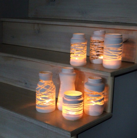 Jar Yarn Lantern Wrap yarn or twine around a jar, paint it, then peel it once it's dry. You are left with a gorgeous luminary for tea lights or candles.