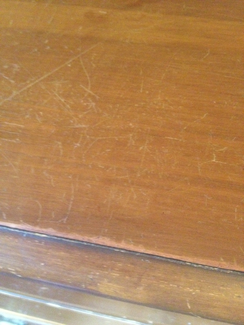 Other end of the scratched up dresser top...