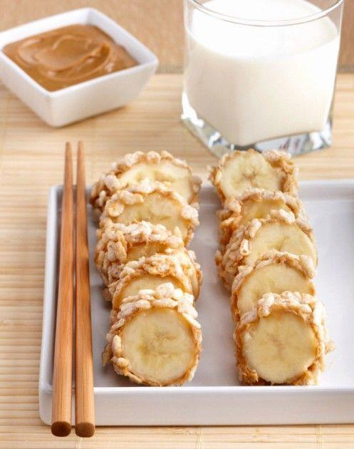 Spread peanut butter over the outside of the banana, and then roll in cereal until coated. Cut into thick slices