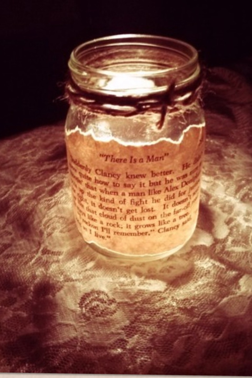 This is cute  Rip a piece of paper out of a book (Don't cut)  Glue is on the outside would be the best thing to do put a tea light in and enjoy