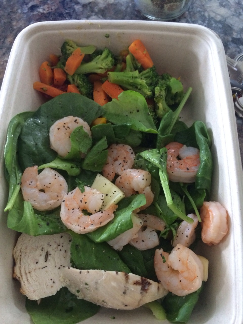 Shrimp weighs next to nothing. Fill your container 1/4 with your choice of lettuce or spinach, a few pieces of vegetables and load up on light proteins like shrimp. This costed $2.83.