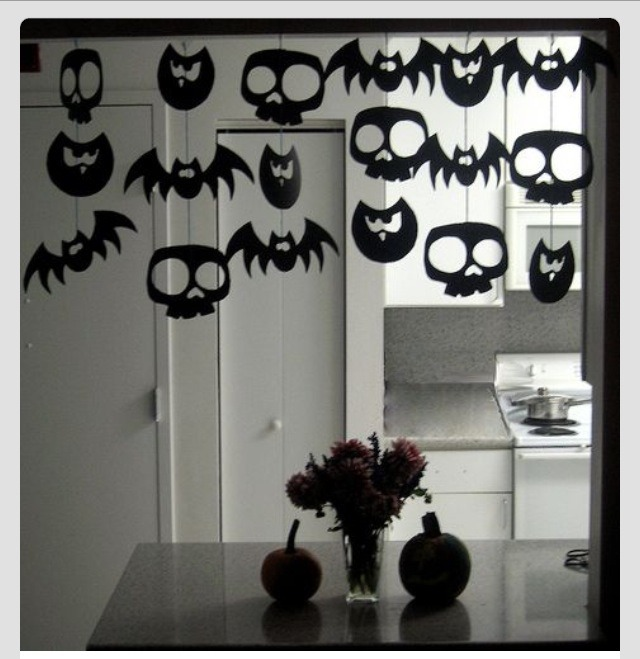 Cut silhouettes out of construction paper and string them together.