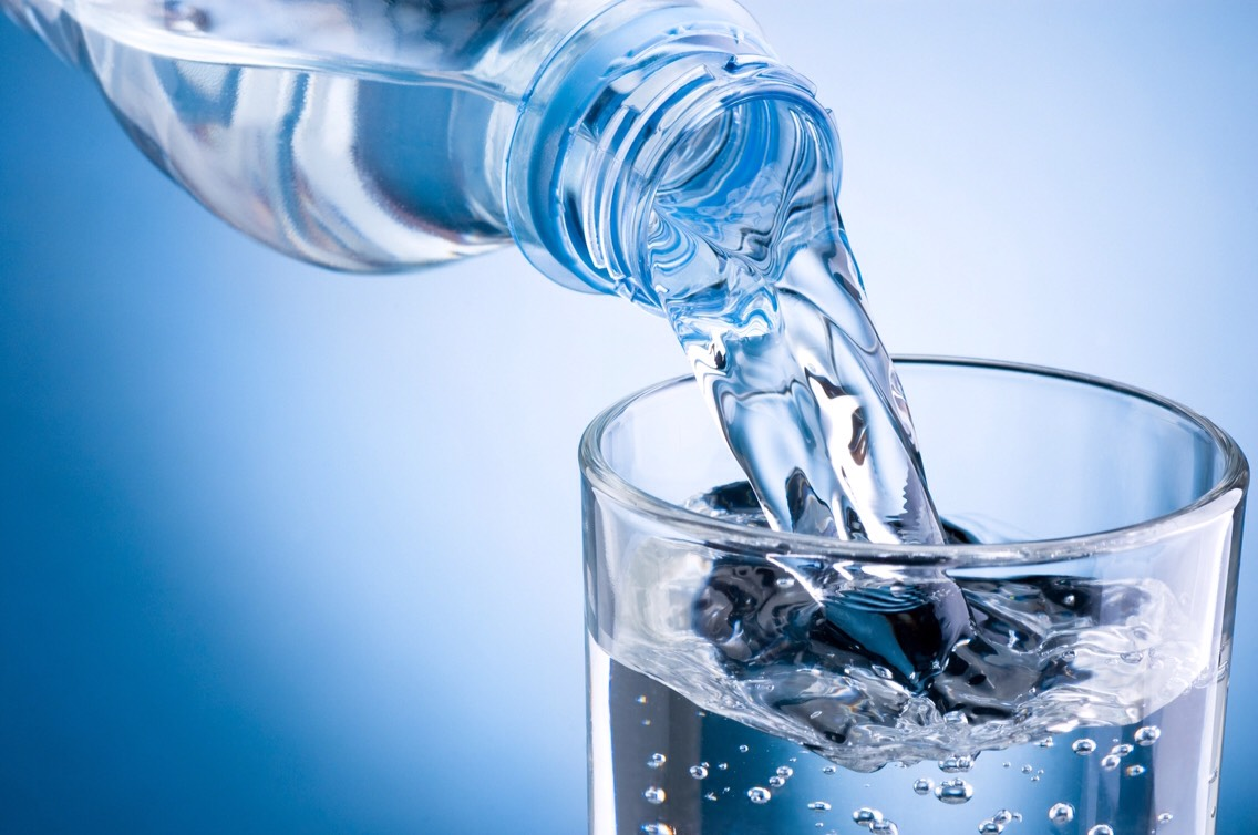 Easiest way to reduce muscle soreness is to drink up! Dehydration can cause massive amounts of muscle soreness. And don't just drink post workout. If you keep hydrated all day you will significantly lower your soreness levels!