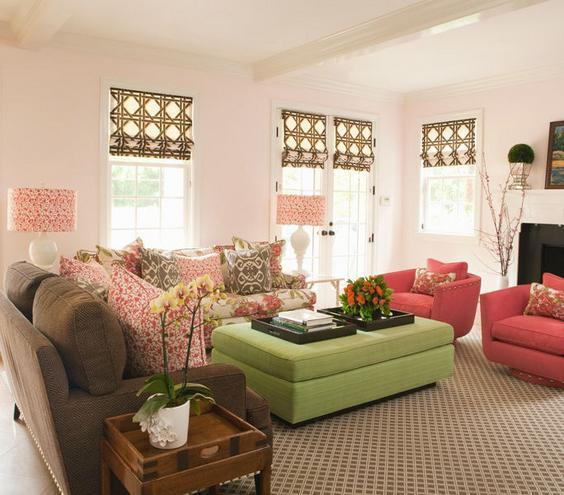 Pattern Play Trellis, ikats, florals—oh my! The trick to mixing patterns is to pick a color theme—here, reds, browns, and blues—and to use big swaths of solid color (the brown sofa, red chairs, and green ottoman) to anchor the space.