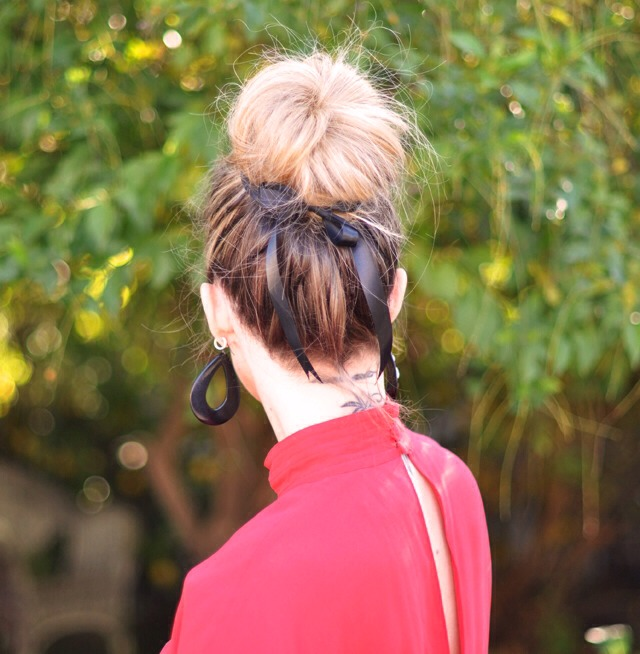 How to create this romantic bun... 1. Begin with your hair in a ponytail for a tighter look, or simply swoop your hair up and twist it around your fingers.  2. Secure it in place with your pins, and if it's too perfect, use your fingers to pull it out and mess it up a bit.