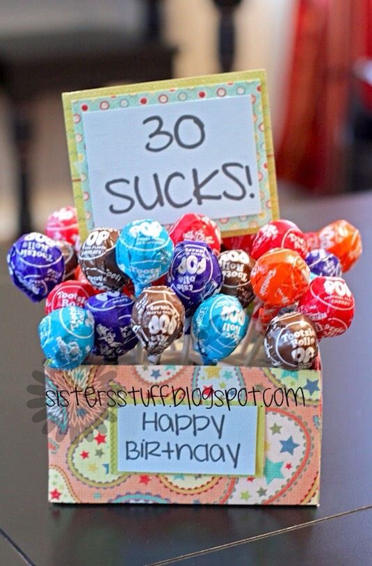 26. Bouquet of Suckers 30! I beg to differ. I happen to like the 30's, but really this could work for any age. I think this is a fun and creative gift for a co-worker or sibling. You could also put the suckers in something that is usable like a coffee mug.