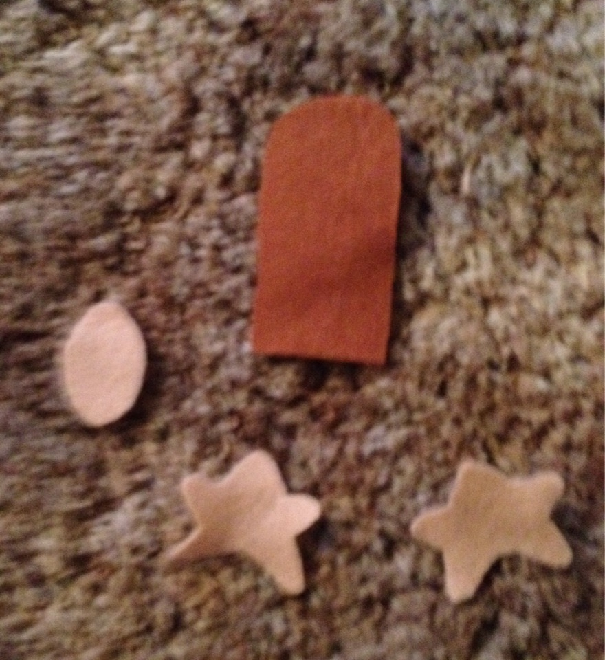 Sorry it's a little blurry.  Cut out your shapes. When you find a shape you like I recommend tracing it on the felt so you have a good pattern.