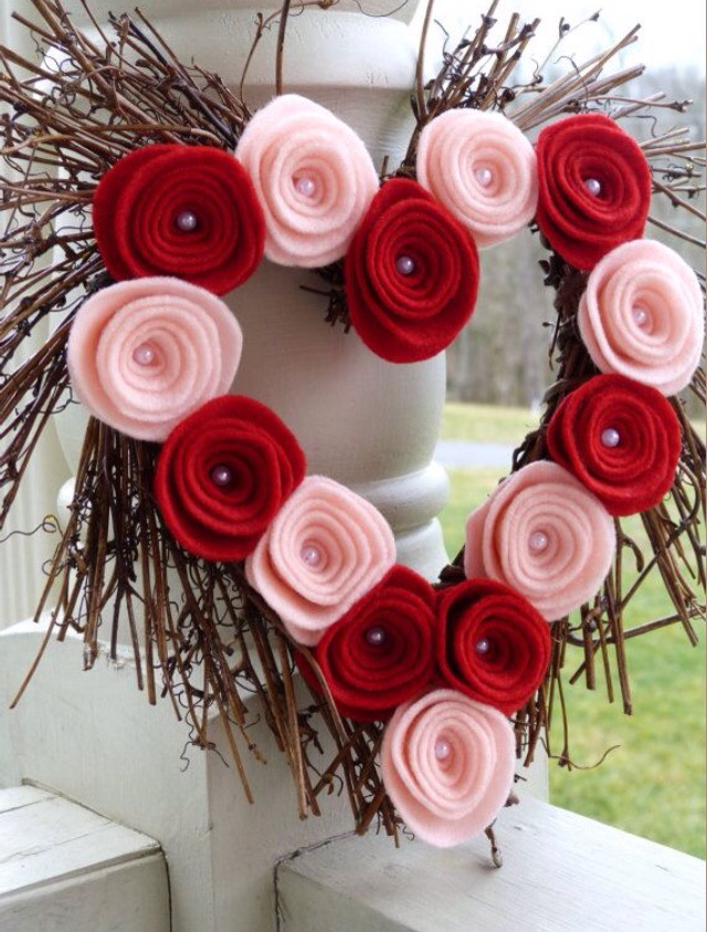 Make felt roses using different sizes of circle felt. Then glue onto a wreath made of twigs.